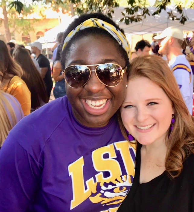 Two students enjoying LSU tailgating